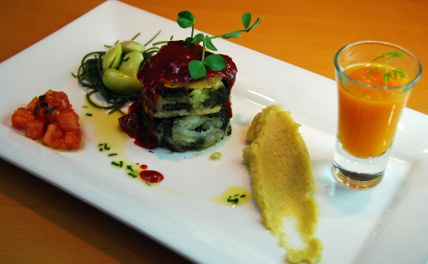 Layered spinach and potato, with beetroot and tomato sauce