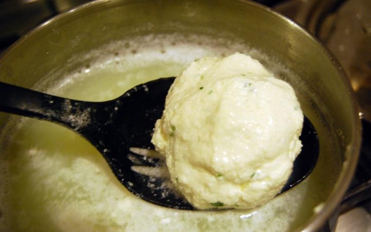 Dunking the mozzarella into whey